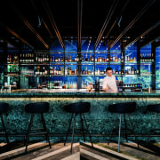 In West Hotel's lobby and restaurant bar, a bar, night, water, black