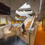 Stairs winding up through Synergy's atrium space provide architecture, interior design, brown