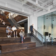 Made of reclaimed oak, the  wide, open staircase interior design, lobby, staircase, Chicago Tribune,  office space, Eastlake Studios