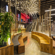 A large chandelier-sculpture lights the way in the interior design, lobby, mixed use, brown, black