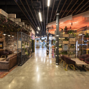 A sightline runs right through the food concourse interior design, restaurant, black, brown