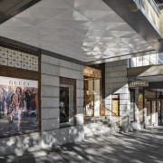 High-profile retail tenants in Melbourne's T&G Building make building, interior design, lobby, gray, black