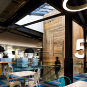 At Xero's Wellington head office, the stairs and architecture, building, cafeteria, ceiling, design, furniture, house, interior design, lighting, restaurant, room, black