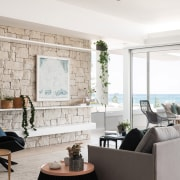 Natural exterior cladding is echoed as interior accents coffee table, floor, flooring, furniture, home, interior design, living room, furniture, furnishings, Overton Apartments,  Banham Architects,