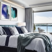 ​​​​​​​This master bedroom features watercolours by one of apartment, architecture, bedroom, furniture, home, interior design, suite, table, paintings, Archer Design