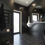 For this bathroom by designer Celia Visser, the architecture, bathroom, floor, flooring, tiles, home, house, plumbing fixtures, black, Vanity
