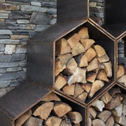 ​​​​​​​Corten steel was an apt material choice for architecture, hearth, rock, wall, firewood, Condon Scott