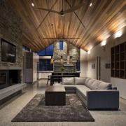 ​​​​​​​Polished concrete floors run through this home. Besides architecture, building, design, floor, flooring, furniture, home, house, interior design, lighting, living room, timber ceiling, fireplace, Condon Scott Architects
