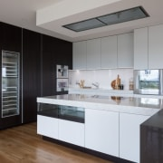 ​​​​​​​For design harmony on this kitchen, designer Lara architecture, cabinetry, countertop, benchtop, floor, timber, hardwood, kitchen, wood flooring, Lara Farmilo, Akzente, Poggenpohl