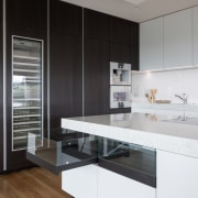 ​​​​​​​For design harmony on this kitchen, designer Lara architecture, cabinetry, countertop, benchtop, Ceasarstone, floor, flooring, kitchen, white, Akzente, Lara Farmilo, Poggenpohl