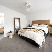 ​​​​​​​The bedhead and side tables in this master architecture, bed, bedroom, floor, flooring, furniture, ight fixture, ensuite, McMahon & Nerlich, bathroom