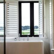 Bathroom design complements farm and river outlooks through bathroom, floor, flooring, glass shower, tile, Peta Davy, Yelowfox, shutters