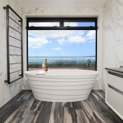A freestanding Idaho stone bath is a feature architecture, blue, building, ceiling, daylighting, floor, flooring, furniture, hardwood, home, house, interior design, laminate flooring, living room, property, real estate, room, sea, sky, wall, window, wood, wood flooring, gray
