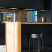 ​​​​​​​Mirror splashbacks add to the sense of space architecture, bar stool, kitchen, timber, glass splashback, stool, table, wood, wood stain, black, impact kitchens