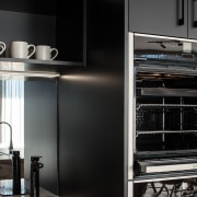 ​​​​​​​Black cabinetry by its nature can make a cabinetry, countertop, cupboard, door, interior design, kitchen, kitchen appliance, black, splashback, mirror, Impact kitchens