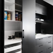 Black and bold, this kitchen makes a strong architecture, black, black-and-white, cabinetry, countertop, cupboard, floor, furniture, home, house, interior design, kitchen, monochrome, shelf, shelving, black, white, Impact Kitchen