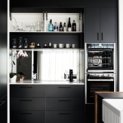 Black and bold, this kitchen makes a strong black-and-white, cabinetry, countertop, cupboard, home, home appliance, kitchen, kitchen stove, oven, Fisher & Paykel, small appliance, black, white, Impact Kitchens
