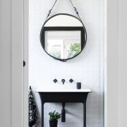 ​​​​​​​On this bathroom project by Minosa, stepping the mirror, bathroom, table, white, black, freestanding vanity, round mirror, Minosa, Darren Genner