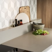 Turning the rear benchtop up the wall added ceramic, countertop, interior design, kitchen, shelf, tile, wall, white