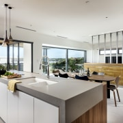 Kitchen with quite a view – this kitchen's architecture, black-and-white, cabinetry, countertop, benchtop, design, floor, flooring, furniture, kitchen, lighting, gray, Ceasarstone, tap, Nadia Clark, Riverstone Custom Homes