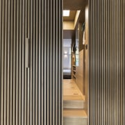 This walk-in closet creates a 'heart of oak' architecture, door, floor, hall, house, interior design, walk in closet, storage spaces, Cantero Architects, Apartment
