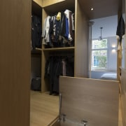 With additional compartments inside the raised floor, this architecture, building, cabinetry, closet, cupboard, floor, furniture, interior design, shelf, shelving, wardrobe, Cantero
