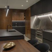 ​​​​​​​Creating a sense of symmetry was critical to architecture, cabinetry, countertop, splashback, backsplash, stainless steel, interior design, kitchen, Cube Dentro, Dekton domos