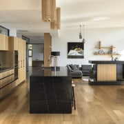 The rich warmth of timber and the sheer architecture, building, cabinetry, ceiling, countertop, floor, flooring, furniture, hardwood, home, house, interior design, kitchen, kitchen stove, laminate flooring, living room, loft, material property, property, real estate, room, table, tile, wood, wood flooring, white
