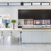​​​​​​​This kitchen features a window as a splashback, architecture, kitchen, cabinetry, countertop, floor, flooring, furniture, home, house, interior design, kitchen, dining table, tile, white, gray, O'Neil Architecture