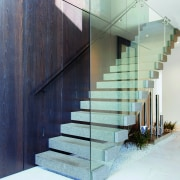 ​​​​​​​The feature staircase in this entry hall is architecture, building, design, staircase, handrail, home, house, interior design, material property, cantilevered stairs, O'Neil Architecture