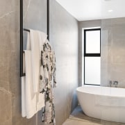 Hang 'em high! Ceiling hung towel rails provide architecture, bathroom, bathtub, ceramic tiles, floor, flooring, house, interior design, plumbing fixture, taps, tiles, wall, towel rail