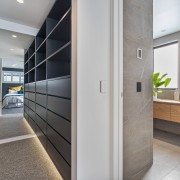 A long walk-through dressing area connects the master architecture, floor, flooring, furniture, glass, house, interior design, room, walk through wardrobe, dressing room, yellowfox, QPC