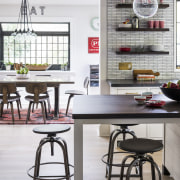 ​​​​​​​This completely reinvented kitchen is a few short bar stool, cabinetry, countertop, dining room, floor, flooring, furniture, home, house, interior design, kitchen, Studio Dearborn