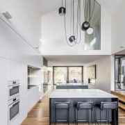 ​​​​​​​Designed for family living, this large kitchen has house, architecture, building, cabinetry, countertop, design, dining room, floor, flooring, furniture, hardwood, home, house, interior design, kitchen, laminate flooring, table, white, wood, wood flooring, CplusC Architectural Workshope