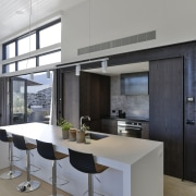 This kitchen island is ideally set for prepping architecture, kitchen, cabinetry, countertop, dining room, floor, flooring, furniture, interior design, kitchen, living room, Koia Architects