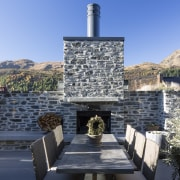 ​​​​​​​For this Arrowtown home, the schist wall and Home, building, outdoor fire, cottage, home, house, landscape, , rock, stone wall, Koia Architects
