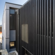 What neighbours? What baking sun? A slatted screen architecture, building, facade, home, house, wall, black.Koia Architects, slatted screens