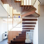 ​​​​​​​Steel rods dipped in brass are suspended 7.3m architecture, Penthouse, stairway, handrail, home, interior design, stairs, wood, suspended stairway, Andrew Wilkinson