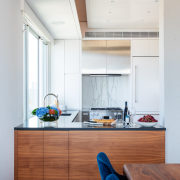 ​​​​​​​The revamped kitchen in this Manhattan penthouse is apartment, penthouse, architecture, cabinetry, countertop, benchtop, cupboards, floor, flooring, home, interior design, kitchen, Andrew wilkinson