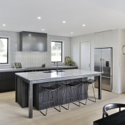 ​​​​​​​A modest office is separated from this kitchen architecture, building, cabinetry, ceiling, countertop, floor, flooring, furniture, home, house, interior design, kitchen, material property, property, real estate, room, table, tile, gray