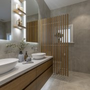 ​​​​​​​Small display shelves are underlit in this bathroom gray