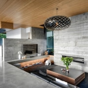 ​​​​​​​The home's tilt slab concrete walls have a architecture, building, ceiling, concrete, design, floor, flooring, furniture, home, house, interior design, living room, lobby, property, real estate, room, table, tile, wall, gray