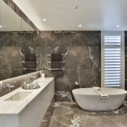 Soaking in the scenery – the curvaceous freestanding architecture, bathroom, bathtub, building, ceiling, ceramic, design, floor, flooring, furniture, glass, home, house, interior design, marble, plumbing fixture, property, real estate, room, tap, tile, wall, gray
