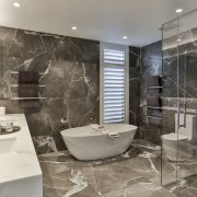 ​​​​​​​Large format porcelain tiles in a luxurious veined architecture, bathroom, bathtub, black-and-white, building, ceiling, floor, flooring, home, house, interior design, marble, plumbing fixture, property, real estate, room, tile, wall, gray