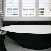 ​​​​​​​Pride of place – for this master ensuite architecture, bathroom, bathroom sink, bathtub, black, floor, flooring, home, interior design, jacuzzi, material property, plumbing fixture, property, room, sink, tap, tile, black, white