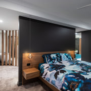 ​​​​​​​Dark wall and cabinet tones accentuate the warmth architecture, bed, bed frame, bed sheet, bedding, bedroom, building, ceiling, floor, furniture, hardwood, home, house, interior design, linens, loft, mattress, property, real estate, room, suite, wall, wood flooring, gray, black