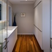 The scullery allows direct passage from kitchen to architecture, building, ceiling, door, floor, flooring, furniture, glass, hall, handrail, hardwood, home, house, interior design, property, real estate, room, wall, wood, wood flooring, gray