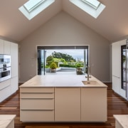Part of a wider renovation of an old architecture, building, cabinetry, ceiling, countertop, daylighting, design, floor, flooring, furniture, hardwood, home, house, interior design, kitchen, lighting, living room, property, real estate, room, table, window, wood flooring, gray, brown