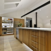 In this kitchen by designer Kira Gray, the gray, brown