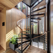 A spiral staircase leads to bedrooms on the brown, gray
